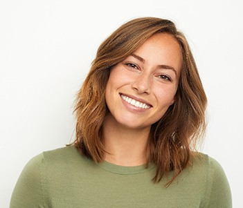 smiling person wearing a green shirt
