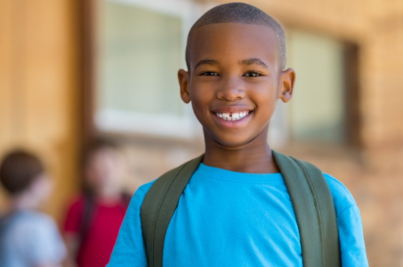 Young boy smiling on first day of school