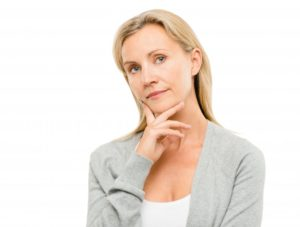 woman wondering how to find the best implant dentist